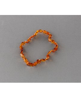 Baby amber necklace - flat cognac olives