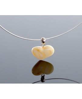 White amber heart-pendant with silver loop