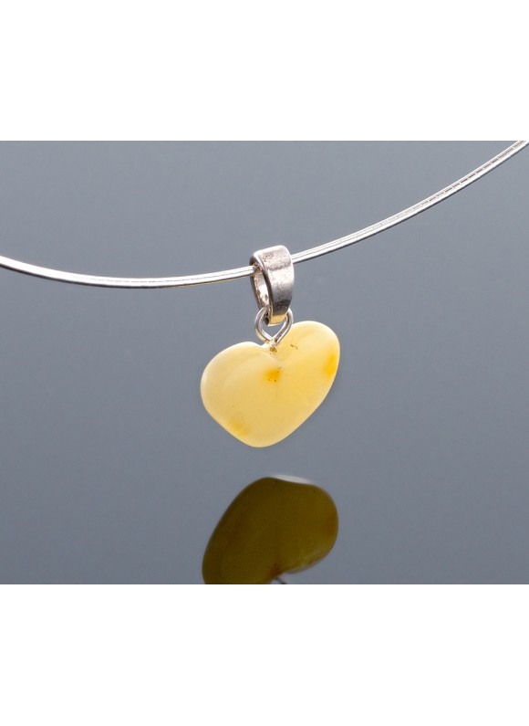 Milky amber heart-pendant with silver loop